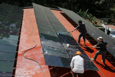 Cleaning solar panels at Hospitalito Atitlán